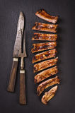 Spare Ribs. Barbecue spare ribs sliced as closeup on a slate slab royalty free stock image
