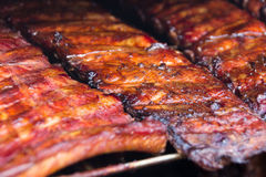 Spare ribs on grill - smoked pork ribs Stock Photos
