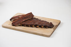 Spare ribs on wooden plate Royalty Free Stock Image