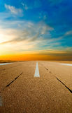 Spare the runway stretches into the distance. At sunset Royalty Free Stock Photography