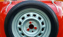 Spare tire on back of red vintage car Royalty Free Stock Images