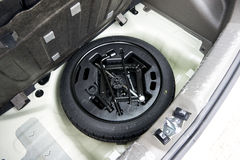 Spare tire in car Stock Photo