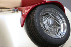 spare tire with chrome rim of an ancient vintage car Royalty Free Stock Images