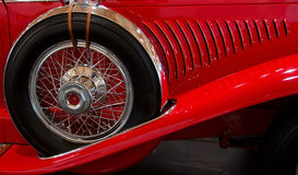 Spare tire on old red sport car. Spare tire attached to a side of an old red sport car Royalty Free Stock Photo