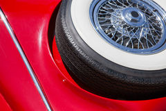 Spare tire on an red retro car Stock Photography