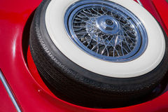 Spare tire on an red retro car Stock Image