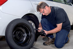 Spare tire replacement with a jack Royalty Free Stock Photography