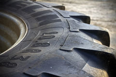 Spare tractor tyre. Spare tractor tire or wheel on the farm Stock Image