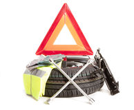 Spare wheel. A spare wheel and all the tools necessary to change Stock Photos