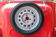 Spare wheel on bottom car Royalty Free Stock Image