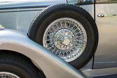 Spare wheel. Close up of a side spare wheel of a vintage car Royalty Free Stock Photos