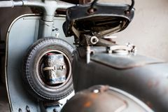 Spare wheel with oil can of old, rusty italian  scooter Stock Photo