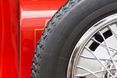 Spare wheel of a red car Stock Photos