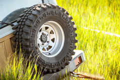 Spare wheel with smile icon  in the middle. Royalty Free Stock Photo