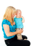 Spared mom crying baby. Mother comforting a crying child Royalty Free Stock Photography