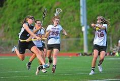 Spareggi delle ragazze di Lacrosse Fotografie Stock Libere da Diritti