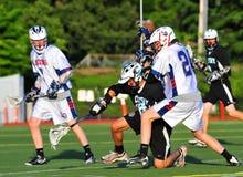 Spareggi di Lacrosse dei ragazzi Fotografia Stock