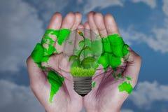 Sparen ons wereld en energieconcept stock afbeeldingen