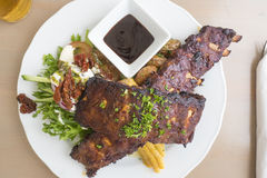 Spareribs with corn, salad and potatos Royalty Free Stock Images