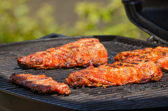 Spareribs on grill with hot marinade Stock Photography