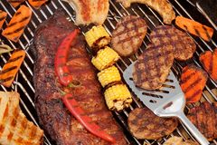 Spareribs, Steaks, Hamburger Patties, Corn And Pepper On The Gri Stock Image