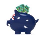 Spargris med den australiska dollaren Arkivbilder