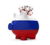 Spargris med den ryska rublet Arkivbild