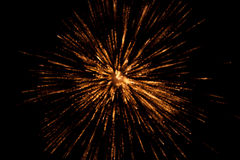 Spark, blast background. Blurred orange and yellow background of a fire spark or blast. Dark background Stock Photo