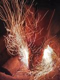 Spark. Fire up the night with spark of light bright enough Royalty Free Stock Photo