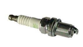 Spark Plug. New shiny spark plug on the white background Stock Photos