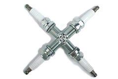 Spark plug as cross Stock Photo