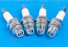 Spark-plug on the blue Stock Photo