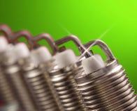 Spark plug on green background. Spark plug on green background stock image