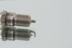 Spark plug on mirror Stock Photos