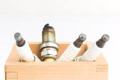 Spark plug in wood box Stock Photo