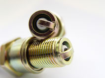 Spark Plugs. Two Spark Plugs one on top of each other, with white background Royalty Free Stock Photos