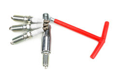Spark plugs and spark-plug key Royalty Free Stock Image