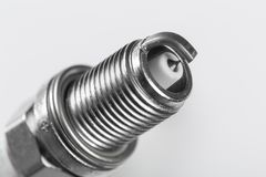 Spark plugs on white background, shallow depth of field stock photo