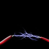 Spark between two wires. With room for copy Royalty Free Stock Photography