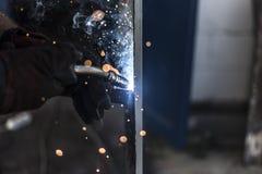 Spark 2. Welder is welding metal construction Stock Photo