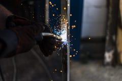 Spark 3. Welder is welding metal construction Stock Photo