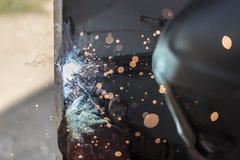 Spark 4. Welder is welding metal construction Royalty Free Stock Photos