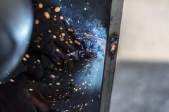 Spark 6. Welder is welding metal construction Stock Photo