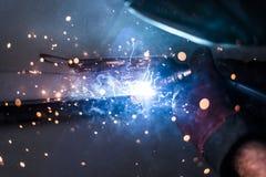 Spark 7. Welder is welding metal construction Stock Images