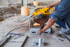 Spark from worker cutting metal by hacksaw Stock Image