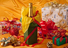 Sparkilg wine and Christmas gifts Royalty Free Stock Images