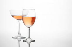 The sparking rose wine in the wine glass couple set Stock Photos