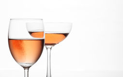 The sparking rose wine in the wine glass couple set Royalty Free Stock Image