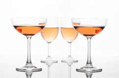 The sparking rose wine in the wine glass group set Royalty Free Stock Photos