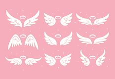 Sparkle angel fairy wings with gold nimbus, halo isolated on background. Vector cartoon design.  vector illustration